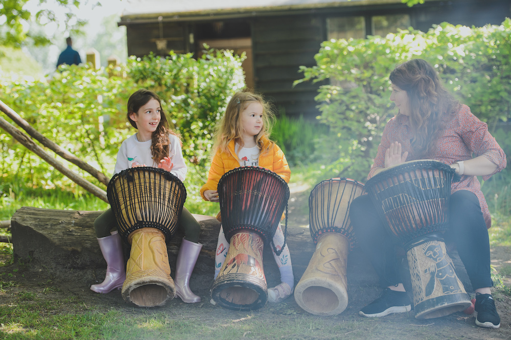 children learning to play drums